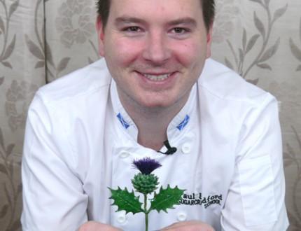 Paul holding sugar Scottish thistle