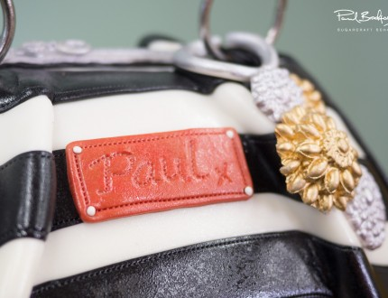 Close up of badge on handbag cake