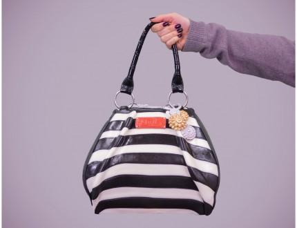 handbag cake suspended