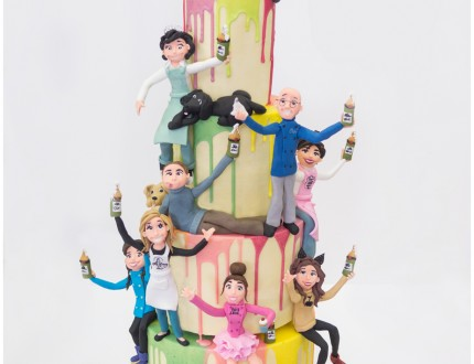 Image of models on melted rainbow cake