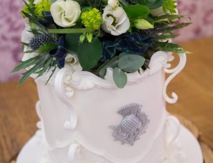 Close up of alternative flower arrangement on top of cake