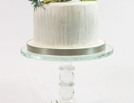 Image of cake with sea holly sugar flowers on top