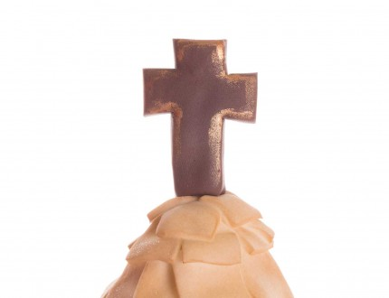 Close up of cross on bridal party cake
