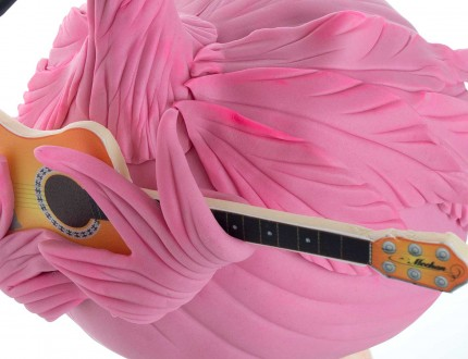 flamingo holding guitar