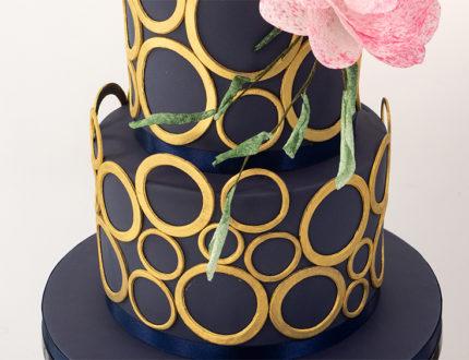 navy and gold wedding cake bottom tier
