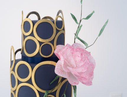 navy and gold wedding cake top tier and flower